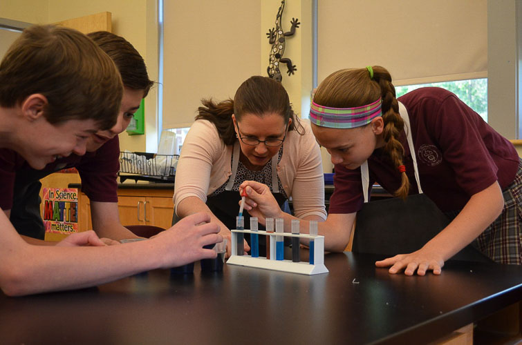 St. Norbert students conduct experiments in the school's science lab.