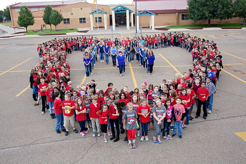 Mesa students love their school!  Students formed a heart with teachers making an M for Mesa in the middle.