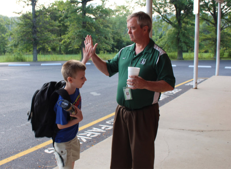 Happy to be back at Miamitown, students and staff high-five.