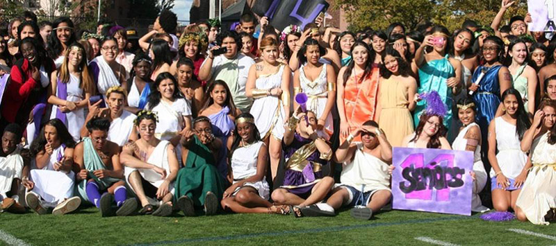 Seniors celebrating a Classical tradition of toga day at Homecoming.