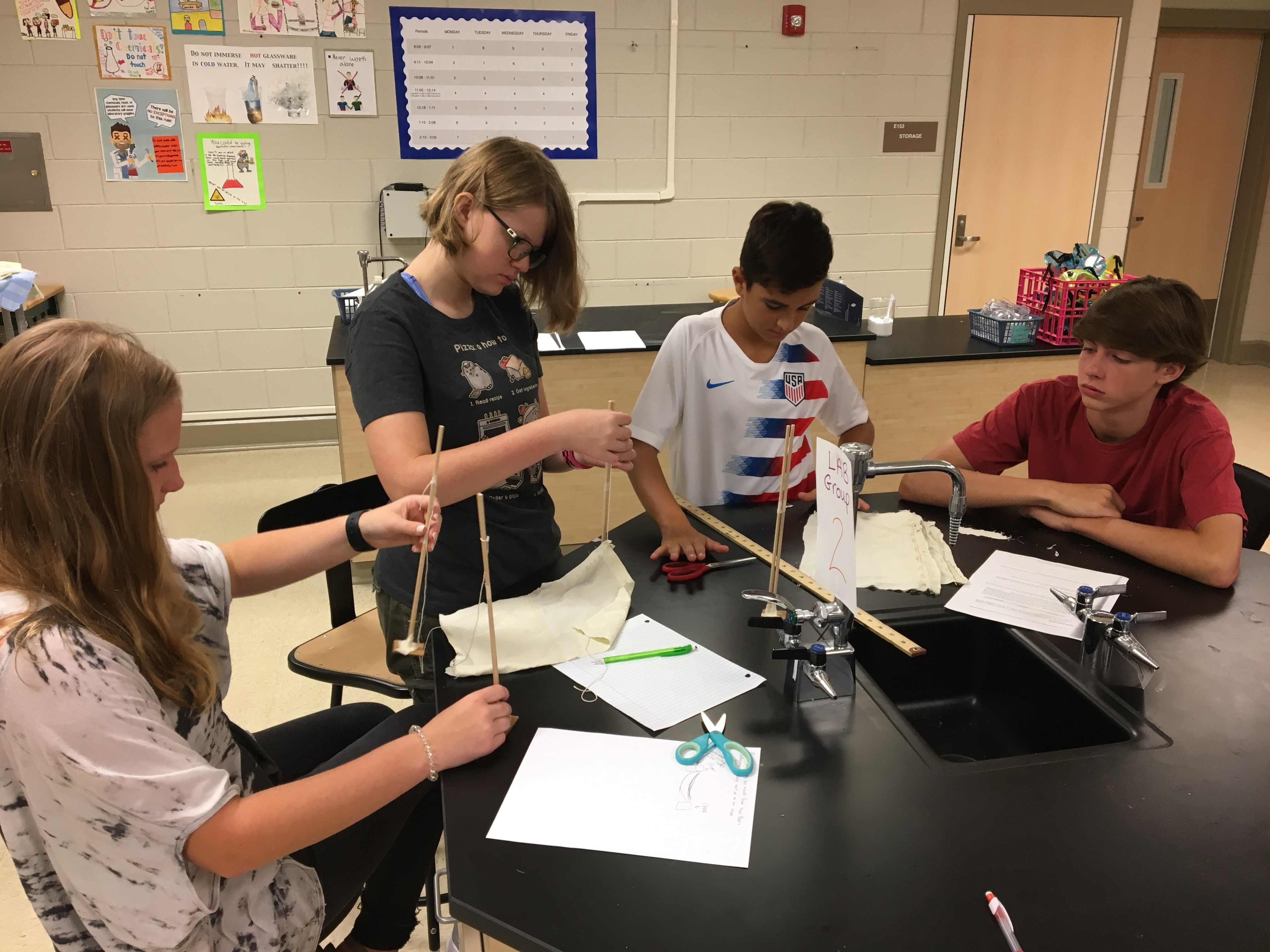 Aspiring engineers construct a STEM hammock to practice scientific inquiry.