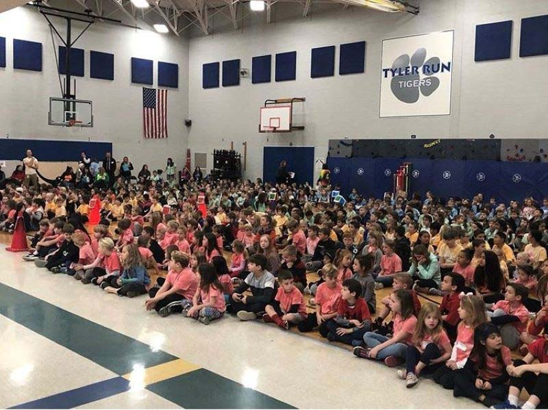 Diversity Houses come together for an assembly in matching shirts